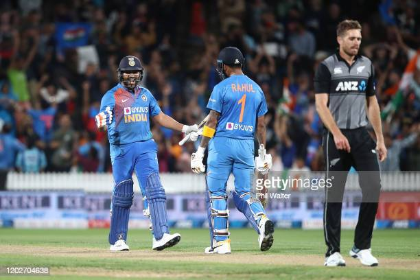 Rohit Sharma of India celebrates hitting the winning 6 on the last ball of the super over with KL Rahul during game three of the Twenty20 series...