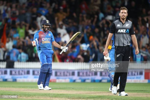 Rohit Sharma of India celebrates hitting the winning 6 on the last ball of the super over during game three of the Twenty20 series between New...