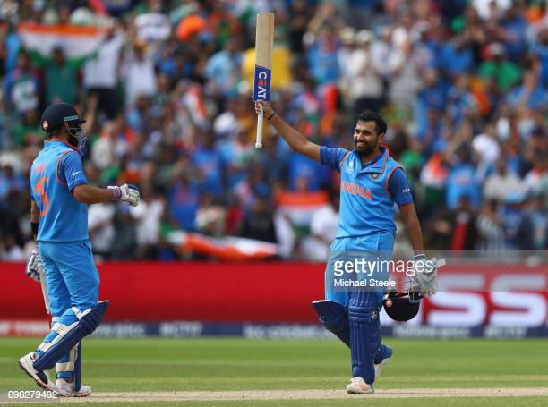 Rohit Sharma of India celebrates reaching his century alongside Virat Kohli during the ICC Champions Trophy SemiFinal match between Bangladesh and...