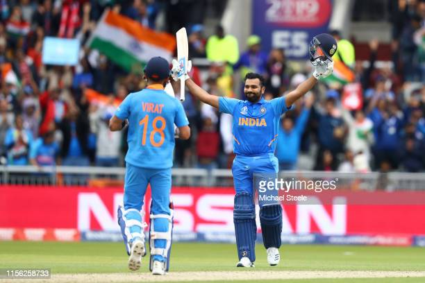 Rohit Sharma of India celebrates reaching his century with captain Virat Kohli during the Group Stage match of the ICC Cricket World Cup 2019 between...