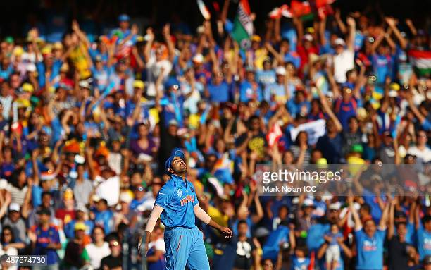 Rohit Sharma of India celebrates taking a catch to dismiss Michael Clarke of Australia during the 2015 Cricket World Cup Semi Final match between...