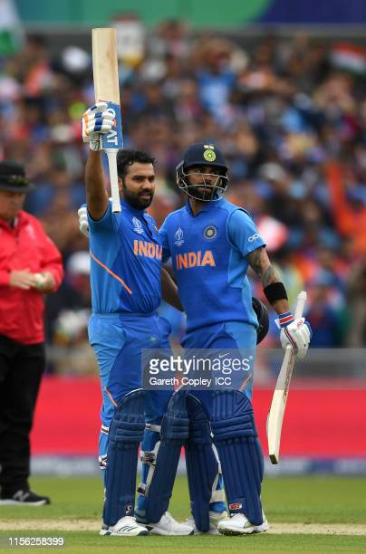 Rohit Sharma of India celebrates with captain Virat Kohli after reaching his century during the Group Stage match of the ICC Cricket World Cup 2019...