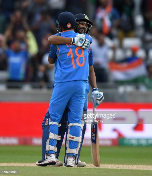 Rohit Sharma of India celebrates with Virat Kohli winning the ICC Champions Trophy Semi Final between Bangladesh and India at Edgbaston on June 15...