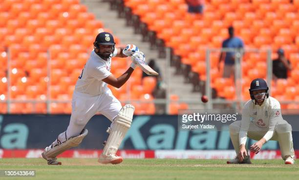 Rohit Sharma of India drives into the covers during Day Two of the 4th Test Match between India and England at Sardar Patel Stadium on March 05, 2021...