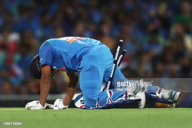 Rohit Sharma of India gets stuck in the stumps during game one of the One Day International series between Australia and India at Sydney Cricket...