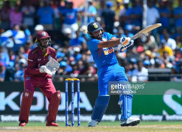 Rohit Sharma of India hits 4 as Nicholas Pooran of West Indies looks on during the 2nd T20i match between West Indies and India at Central Broward...