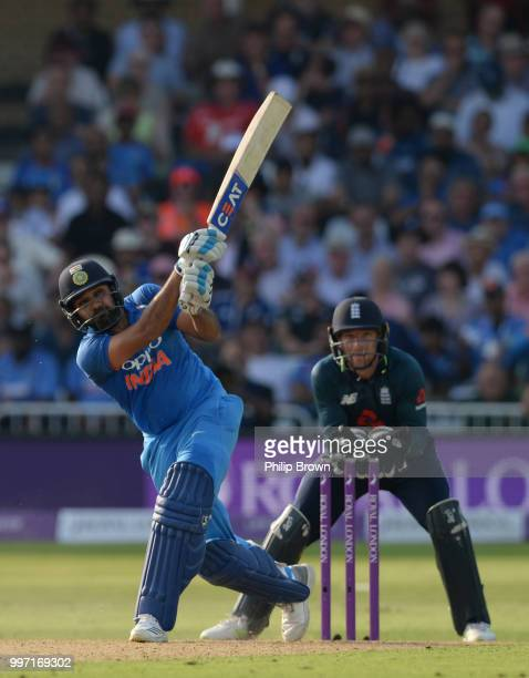 Rohit Sharma of India hits a six as Jos Buttler looks on during the 1st Royal London OneDay International between England and India on July 12 2018...