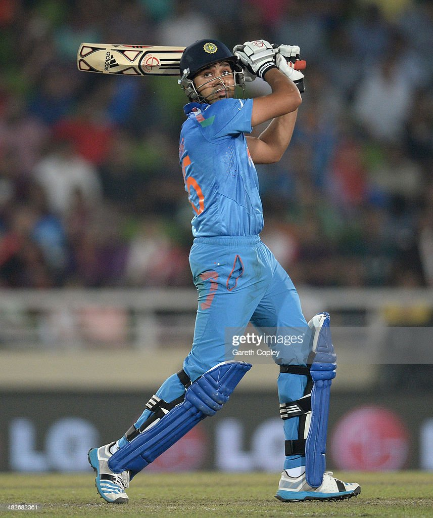 Rohit Sharma of India hits out for six runs during the ICC World Twenty20 Bangladesh 2014 semi final between India and South Africa at Sher-e-Bangla Mirpur Stadium on April 4, 2014 in Dhaka, Bangladesh.