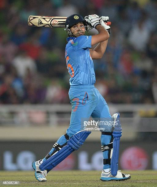Rohit Sharma of India hits out for six runs during the ICC World Twenty20 Bangladesh 2014 semi final between India and South Africa at ShereBangla...