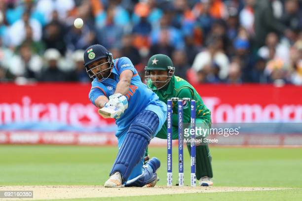 Rohit Sharma of India hits straight as Pakistan wicketkeeper Sarfraz Ahmed looks on during the ICC Champions Trophy match between India and Pakistan...