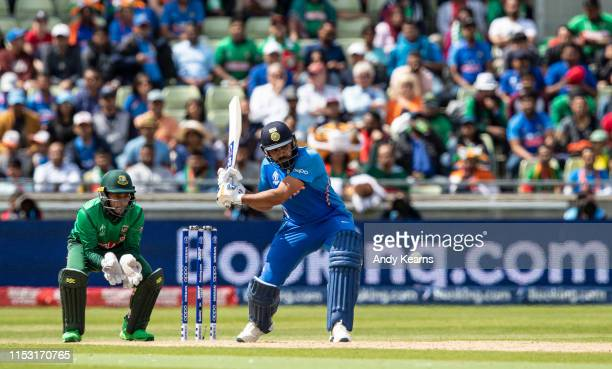 Rohit Sharma of India hits the ball over the boundary for six during the Group Stage match of the ICC Cricket World Cup 2019 between Bangladesh and...