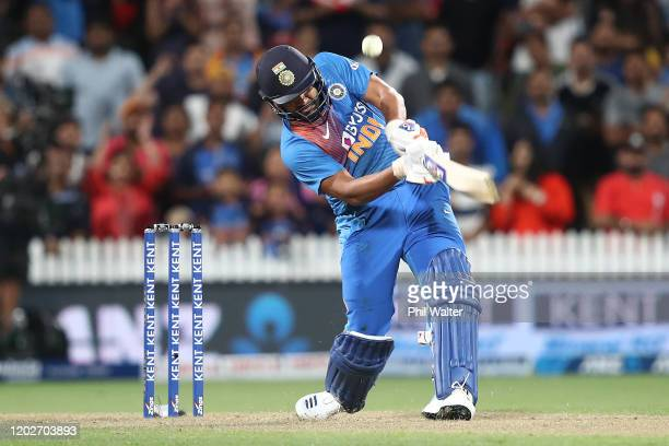 Rohit Sharma of India hits the winning 6 on the last ball of the super over during game three of the Twenty20 series between New Zealand and India at...