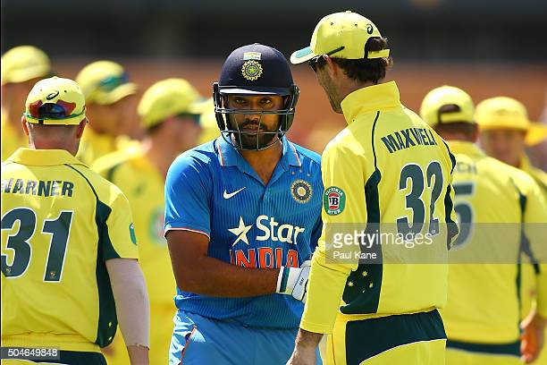 Rohit Sharma of India is congratulated by Australian players at the end of the innings during the Victoria Bitter One Day International Series match...