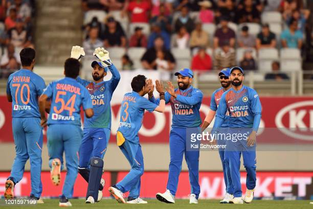 Rohit Sharma of India is congratulated by team mates after taking a catch to dismiss Martin Guptill of New Zealand during game one of the Twenty20...