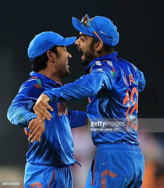 Rohit Sharma of India is congratulated by Virat Kohli after catching David Warner of Australia during the ICC World Twenty20 Bangladesh 2014 match...