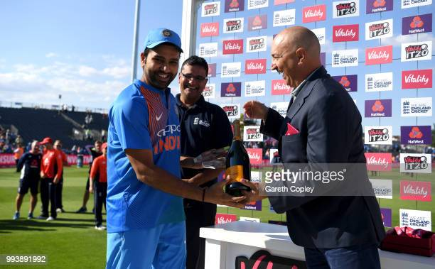 Rohit Sharma of India is presented with his man of the match and series prize after the 3rd Vitality International T20 match between England and...