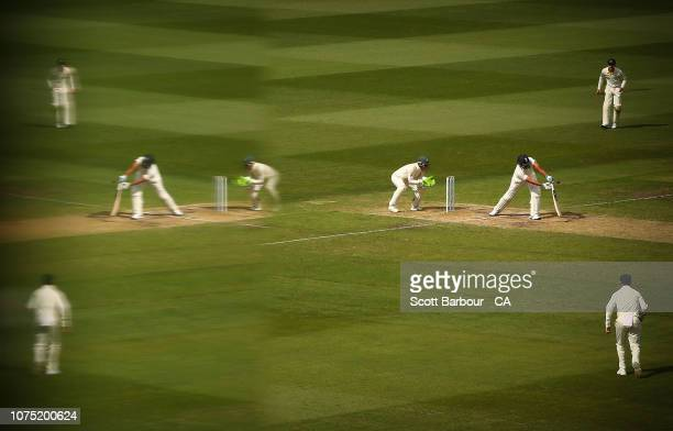 Rohit Sharma of India is reflected in a window as he bats during day two of the Third Test match in the series between Australia and India at...