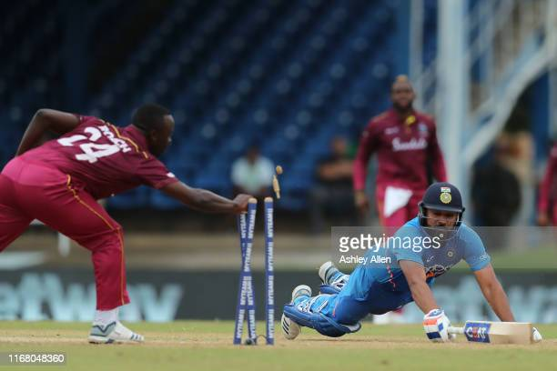Rohit Sharma of India is run-out by Fabian Allen and Kemar Roach of the West Indies during the third MyTeam11 ODI between the West Indies and India...
