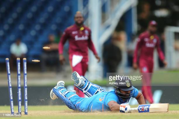 Rohit Sharma of India is run-out during the third MyTeam11 ODI between the West Indies and India at the Queen's Park Oval on August 14, 2019 in Port...