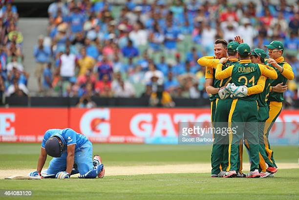Rohit Sharma of India looks dejected after being run out as AB de Villiers and Dale Steyn of South Africa celebrate during the 2015 ICC Cricket World...