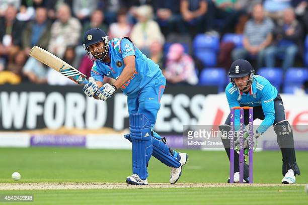 Rohit Sharma of India plays straight as wicketkeeper Jos Buttler of England looks on during the second Royal London OneDay Series match between...