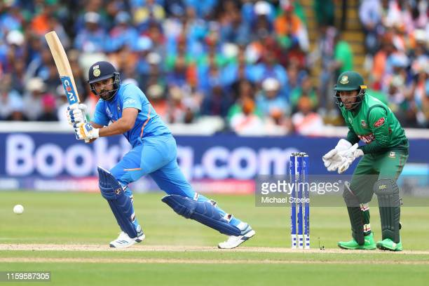 Rohit Sharma of India plays to the legside as Bangladesh wicketkeeper Mushfiqur Rahim looks on during the Group Stage match of the ICC Cricket World...