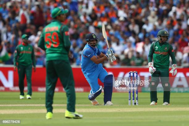 Rohit Sharma of India pulls a delivery to the onside during the ICC Champions Trophy SemiFinal match between Bangladesh and India at Edgbaston on...