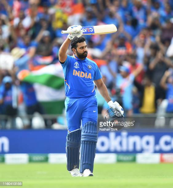 Rohit Sharma of India raises his bat after he scores 100 runs during the Group Stage match of the ICC Cricket World Cup 2019 between Sri Lanka and...