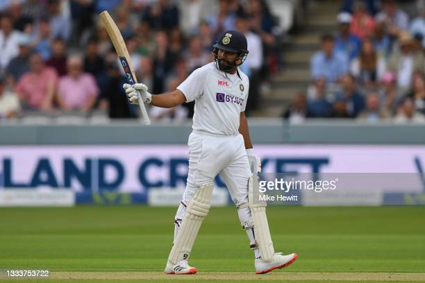 Rohit Sharma of India raises his bat after reaching 50 during the Second LV= Insurance Test Match: Day One between England and India at Lord's...