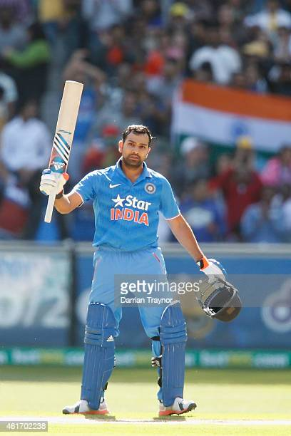 Rohit Sharma of India raises his bat after scoring 100 runs during the One Day International match between Australia and India at Melbourne Cricket...