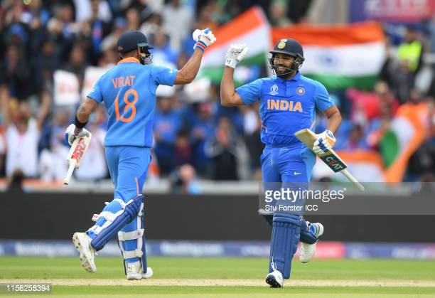 Rohit Sharma of India reaches his century and is congratulated by Virat Kohli of India during the Group Stage match of the ICC Cricket World Cup 2019...