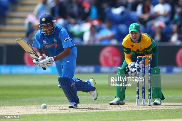 Rohit Sharma of India sets off for a single as wicketkeeper AB de Villiers of South Africa looks on during the Group B ICC Champions Trophy match...