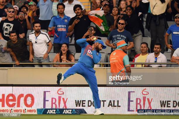 Rohit Sharma of India takes a catch to dismiss Martin Guptill of New Zealand during game one of the Twenty20 series between New Zealand and India at...