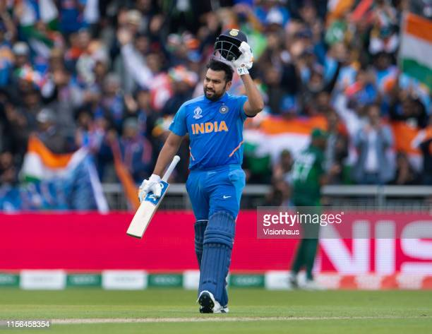 Rohit Sharma of India takes off his helmet and celebrates reaching a century during the Group Stage match of the ICC Cricket World Cup 2019 between...