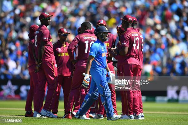 Rohit Sharma of India walks off after being dismissed by Kemar Roach of West Indies during the Group Stage match of the ICC Cricket World Cup 2019...
