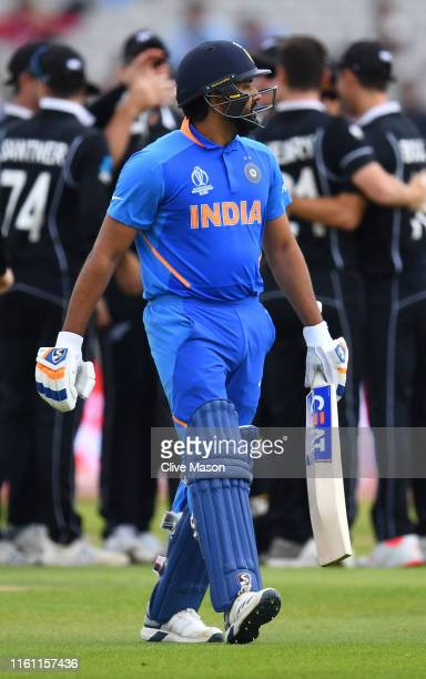Rohit Sharma of India walks off after being dismissed by Matt Henry of New Zealand during resumption of the Semi-Final match of the ICC Cricket World...