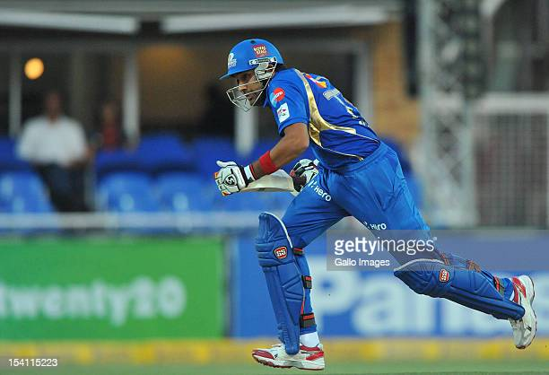 Rohit Sharma of Mumbai runs a single during the Karbonn Smart CLT20 match between bizhub Highveld Lions and Mumbai Indians at Bidvest Wanderers...
