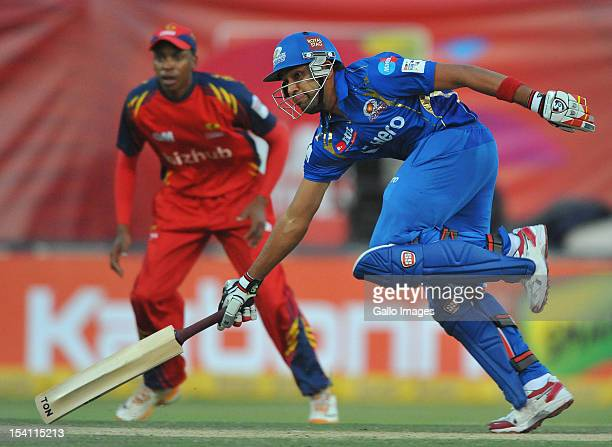Rohit Sharma of Mumbai runs a singlee during the Karbonn Smart CLT20 match between bizhub Highveld Lions and Mumbai Indians at Bidvest Wanderers...
