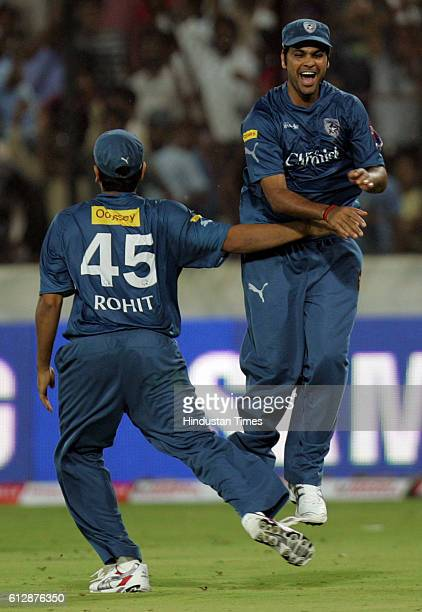 Rohit Sharma of the Chargers congratulates R P Singh on holding the catch to dismiss Peter Trego during the Airtel Champions League Twenty20 Group A...