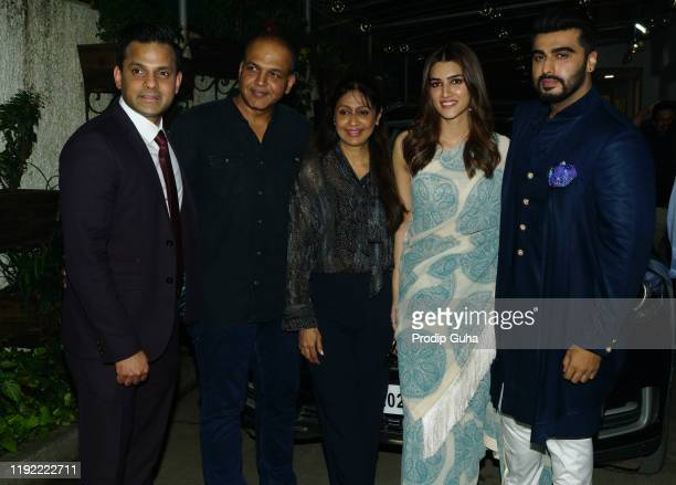 Rohit ShelatkarAshutosh GowarikerSunita GowarikerKriti Sanon and Arjun Kapoor attend the PANIPAT movie screening on December 05 2019 in Mumbai India