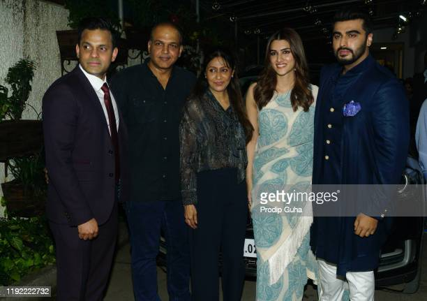 Rohit ShelatkarAshutosh GowarikerSunita GowarikerKriti Sanon and Arjun Kapoor attend the PANIPAT movie screening on December 052019 in MumbaiIindia