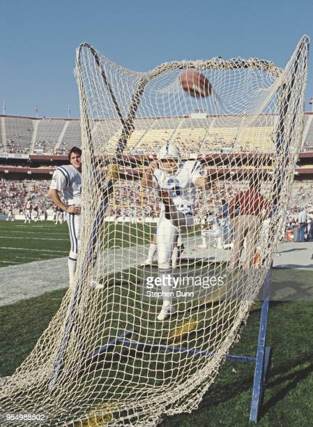 Rohn Stark Kicker and Punter for the Indianapolis Colts practising his kick into the practice net during the National Football Conference East game...