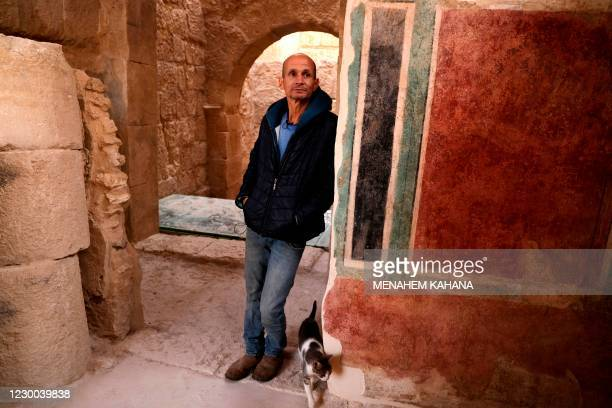 Roi Porat, an archaeologist at the Hebrew University of Jerusalem and head of the Herodium excavation, speaks during an interview with AFP at the...