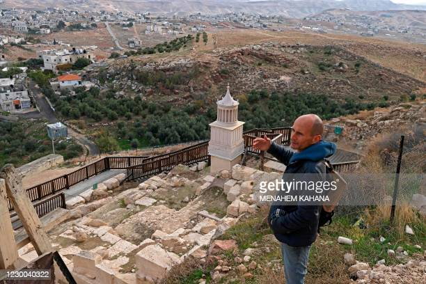 Roi Porat, an archaeologist at the Hebrew University of Jerusalem and head of the Herodium excavation, speaks during an interview with AFP at King...