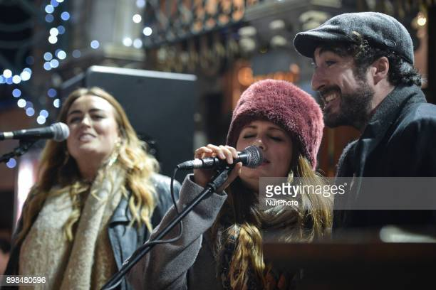 Roisin O and Danny O'Reilly of Coronas take part in the annual Christmas Eve busk in aid of the Dublin Simon Community outside the Gaiety Theater in...
