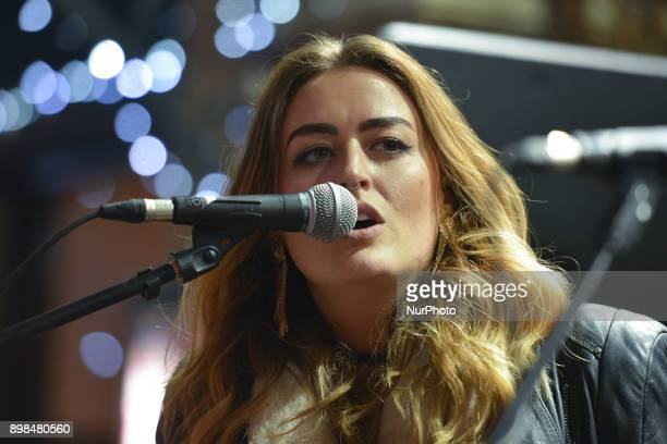 Roisin O takes part in the annual Christmas Eve busk in aid of the Dublin Simon Community outside the Gaiety Theater in Dublin Hundreds attended the...