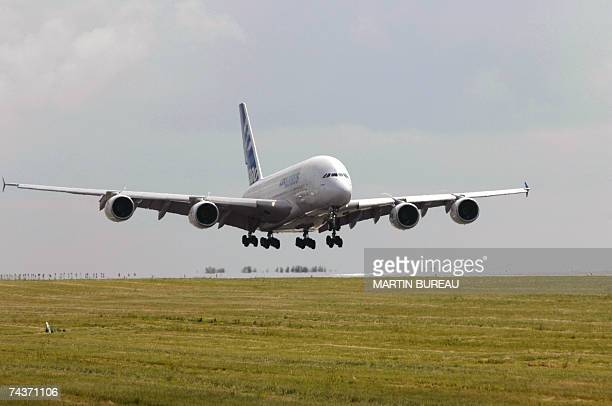 An Airbus A380 plane the new doubledecker 555 passenger jet lands for the first time at the Roissy Charles de Gaulle airport north of Paris 01 June...