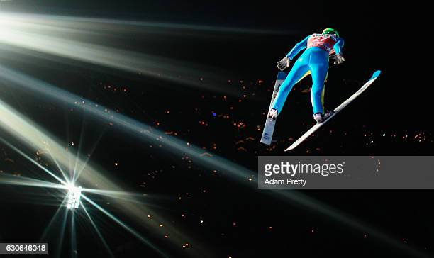 Rok Justin of Slovenia soars through the air during his qualification jump on Day 1 of the 65th Four Hills Tournament ski jumping event on December...