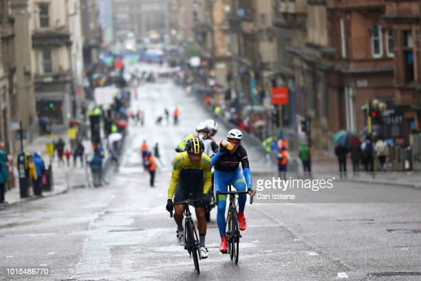 Rok Korosec of Slovenia and Richard Larsen of Sweden ride in the chasing pack in the Men's Road Race during the road cycling on Day Eleven of the...