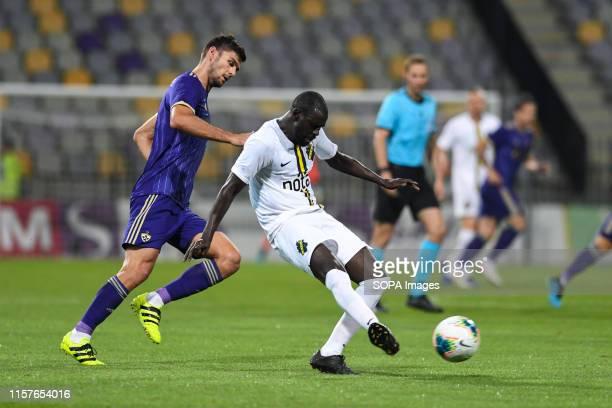 Rok Kronaveter of Maribor and Enoch Kofi Adu of AIK in action during the Second qualifying round of the UEFA Champions League between NK Maribor and...